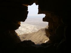 i took this picture on top of massada in israel, through the wall of a roman building, with a nice view on the desert and the dead sea in the background.