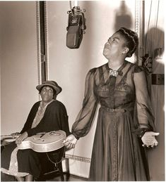 Sister Rosetta Tharpe recording at Decca Records wit' her mother Katie Bell holding her guitar, 1941. via Charles Peterson