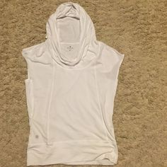 Athleta hooded t-shirt White hooded t-shirt from Athleta. Cute shirt great for working out. This shirt has been worn a few times, but it is in good condition. Athleta Tops Tees - Short Sleeve