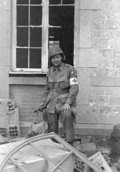 """Capt George """"Chappie"""" B. Wood, O-471681, 505th PIR Protestant Chaplain, pictured in the ruins of buildings somewhere in Ste-Mère-Église."""