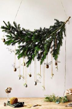 Hang the branch, then hang simple balls or ornaments from it. Gorgeous