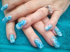 blue and white flowers. Only £29 for acrylic nails and £31 for gels.