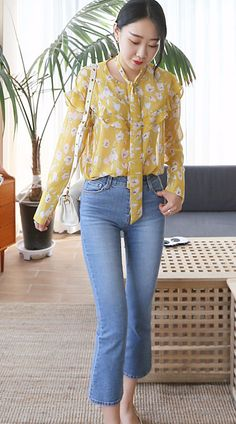 Get into the spirit of spring in this bright floral blouse!