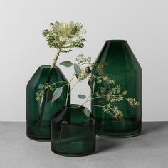 Bring sleek style to your living space with the Green Glass Jug Vase from Hearth & Hand with Magnolia. Whether you're adding in branches with greenery or fresh blooms, this green glass will bring an earthy pop of color to any room. Display it on your entryway table to give guests a warm welcome, or let it flourish as a centerpiece on your kitchen table as an eye-catching focal point.<br><br>Celebrate the everyday with Hearth & Hand — created exclusi...