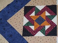 Land of the Midnight Sun quilt block, designed by Judy Martin. The pattern is in Judy Martin's Ultimate Book of Quilt Block Patterns, 1988. Found on billabongs2bling: February 2011