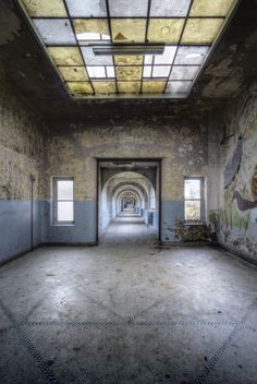 Emmett photographed this corridor when the agricultural school was dilapidated, but it has since been renovated.