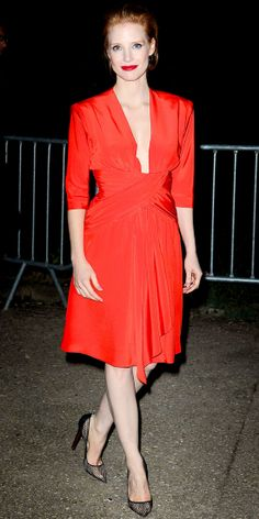 Jessica Chastain took in the Saint Laurent runway show in a plunging dress and sheer stilettos.