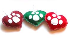Red and green paw print ornaments.  How cute! By forpawsandhome on Etsy