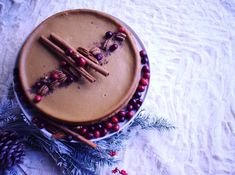 Gingerbread cheesecake with cranberries, pecans and cinnamon sticks. Perfect for Christmas. By Rachel Maria Cakes