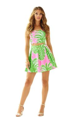 The Parfait Set is for the playful at heart. This two piece bustier top and     pleated skirt set was designed for the Lilly girl who loves to show a slice of  skin. The Pink Pout Flamenco print has pineapples throughout...with a twist in    pink and green. FUN.