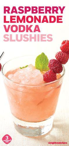 Raspberry Lemonade Vodka Slushies are super easy & refreshing to make! Top them off with fresh raspberries.