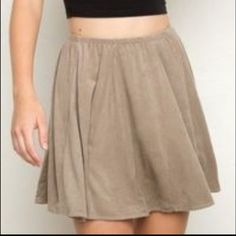 Brandy Melville Beige Suede Skirts Brandy Melville Sanny skirt in a beige color. Pre-owned and barely worn condition in a soft suede-like material. Not sold online anymore and is so cute! Condition: Pre-owned condition. Little stain as you see in the picture. Brandy Melville Skirts Mini