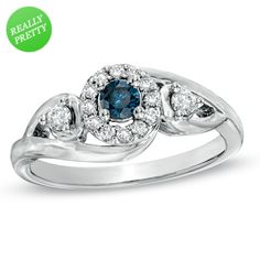 Matt just got me this beauty at Zales: 3/8 CT. T.W. Enhanced Blue and White Diamond Engagement Ring in 10K White Gold!!!!!