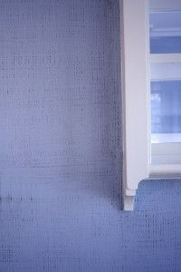 Linen paint finish with periwinkle blue over a chocolate brown base, by Arteriors