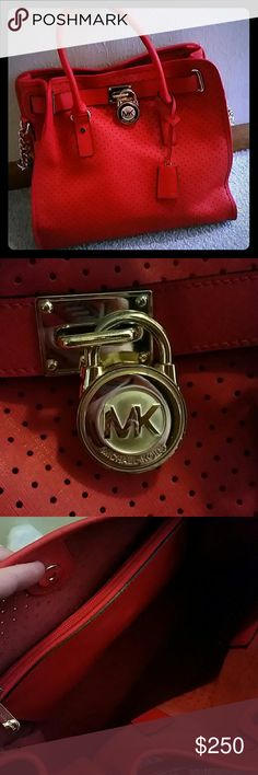 Authentic Michael Kors Hamilton RARE! Large Lipstick red perforated Hamilton bag. Perfect condition. No flaws. Super rare. Has shoulder strap and handles. Reasonable offers will be considered but I'm in no rush to sell it either. It's a beautiful purse! Michael Kors Bags Shoulder Bags