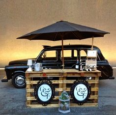 Simple wooden stand with a black umbrella. I like this look, but we need to keep in mind that Pizza Revolution and Wired coffee house also have similar-looking market set-ups.