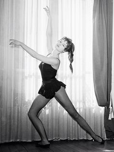 Bardot dancing at her home in Paris.