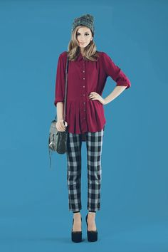 Burgundy long sleeve peplum top with skull buttons matched with black plaid pants and Hilar pumps in black