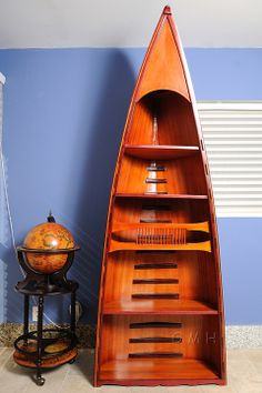 This canoe book shelf was handcrafted from western red cedar and protected by a layer of fiberglass just like the way a real wooden canoe is made. Canoe reddish gunwell was made of rare purple heart wood from south america. It takes more than 200 hours to finish this item by the master craftsmen.