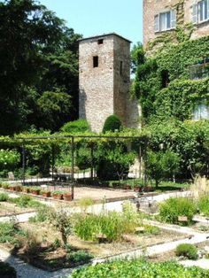 Medieval garden at Chiesa San Pedro, Italy. I like the area of shade using a structure and vines.