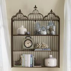 Birdcage Shelf has three hinged shelves and is topped with decorative wire domes and finials. Metal and wire; Easy to assemble. --- Can see this decked out in Halloween spookies or owls! Unique Shelves, Rustic Shelves, Wall Shelves, Shelf, Unique Bookshelves, Wall Storage, Shelving, Bird Bathroom, Decorative Bird Houses