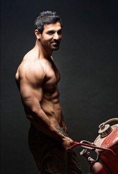 Can a man lift a car? We don't know about man but we do know that John Abraham can. Yes, that particular scene in John Abraham latest Force 2 saw him do just that and no, it was not a doctore… John Abraham Body, Jon Abrahams, Photoshop, Most Handsome Men, Hot Actors, Bollywood Stars, Movie Stars, Beautiful Men, Bodybuilding