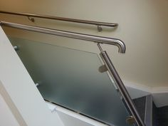 Frosted toughened glass panel infill to staircase with stainless steel handrails and scroll ends Balustrade Design, Glass Balustrade, Stainless Steel Handrail, Glass Center, Balcony Railing, Glass Panels, Sink, Stairs, Home Decor