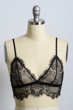 56c0cceeab A sheer lace bralette featuring a v-neckline