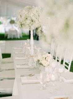 White Reception Table With Babys Breath and Roses