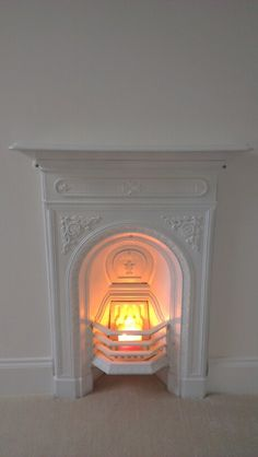 Excellent Screen small Fireplace Hearth Thoughts Painted cast iron fireplace for nursery Candles In Fireplace, Paint Fireplace, Small Fireplace, White Fireplace, Bedroom Fireplace, Farmhouse Fireplace, Fireplace Hearth, Fireplace Kitchen, Fireplace Ideas