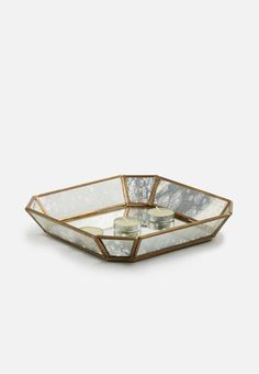 Keep your trinkets on display and within easy reach with this glass tray. Sporting an antique-like look and metal frame, it's the ideal standout addition to your bedside table, even with the most modern and minimalist of decor. Glass Tray, Art Decor, Minimalist, Antiques, Metal, Modern, Accessories, Antiquities, Antique