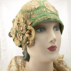 A gorgeous 1920s cloche with vibrant metallic gold couching, embroidery and ribbon. The ground is green, most likely a linen and raw silk blend, with a matte finish.