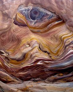COLORFUL STONE IN RED CANYON, SINAI, EGYPT.  Photograph by Zé Eduardo, titled, 'one eye in the Canyon' via Flickr.