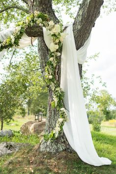 trees draped in fabric and florals