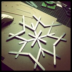 A little metallic spray paint on popsicle sticks and some hot glue and you have jumbo wooden snowflakes to hang. :)