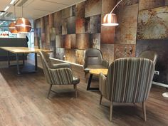 Love this look! Our Steel wallpaper styled with copper lamps.
