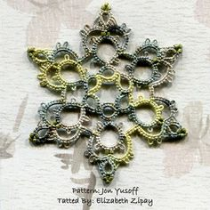 """Alladin"" from Jon Yusoff's ""Tatted Snowflakes Collection."" Tatted snowflakes have been around about as long as tatting itself - so you'd think we'd run out of really different and unique patterns.  Not so with Jon's book, predominantly because of the use of more ""modern"" tatting techniques like the use of two shuttles and split and mock rings. I think the thread is ""Treebeard"" by Lady Shuttlemaker."