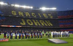 """Football fans mark the words, """"Thankyou Johan"""", in memeory of the late Dutch football legend Johan Cruyff before the """"clasico"""" Spanish league football match FC Barcelona vs Real Madrid CF at the Camp Nou stadium in Barcelona on April 2, 2016."""