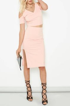 Blush pink midi length skirt with a rectangular side slit cutout. Pair with the Moon Child Top. This skirt runs very largely, the medium=large.   Moon Child Skirt by MinkPink. Clothing - Skirts - Knee Clothing - Matching Sets New York