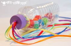 Make bright and colourful Rainbow Sensory Play Bottles. An adaptable sensory play activity and musical instrument for kids too. Great fun for all ages.