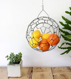 Display the fruits of your garden in this beautiful hanging wire basket. Handmade with steel wire, the large opening lets you easily reach in for a vegetable and leave your counters free for cooking and chopping. Carefully braided to form a sphere, this is a work of art in itself.