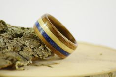 Bentwood walnut ring with maple and blue lapis inlay on Etsy, $160.00