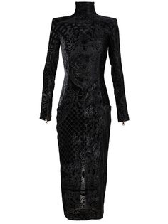 Midnight black devore velvet dress from Balmain. Stand-up neckline. Structured shoulder pads. Long sleeves with exposed zip cuffs.  Exposed zip down back. Two front patch pockets. Curved seams. Large split in the back. Full silk lining. Specialist dry clean only.