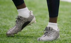 DeAndre Hopkins #10 of the Houston Texans warms up before playing the Chicago Bears at NRG Stadium on Sept. 11, 2016 in Houston. Hopkins is wearing a special pair of Yeezy cleats by Kanye West.