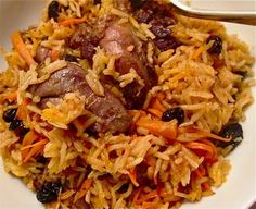 Pilau: Afghan baked rice with lamb - This is SO good!Qabili Pilau: Afghan baked rice with lamb - This is SO good! Afghan Food Recipes, Lamb Recipes, Indian Food Recipes, Asian Recipes, Cooking Recipes, Ethnic Recipes, Afghan Rice Recipe, Cooking Rice, Eid Recipes