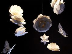 Paper flower and butterfly mobiles http://www.paper-and-arts.com/