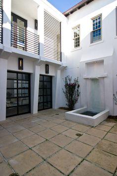 Balcony and garage door courtyard