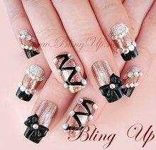Black French Nail Tips with Champagne Glitter Nail Color, 3d Nail Art Ribbon Bow and Rhinestones - Bling Up Inc.