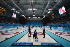 (EDITORS NOTE: Image was created using a variable planed lens) Team USA competes in the men's round robin session against Germany during day four of the Sochi 2014 Winter Olympics at Ice Cube Curling Center on February 11, 2014 in Sochi, Russia. (Photo by Streeter Lecka/Getty ...