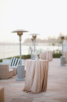 Exact Look For reception decor.How Perfect =) Love the Gold/Champagne Linens and The nautical Pillow!!!
